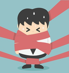 Businessman caught in Red Tape vector