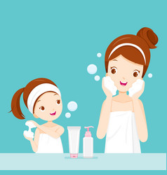 Mother and daughter cleaning and care her face vector