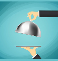 waiter holding a tray with a dome in his hands vector image