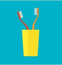 Tooth brush in a yellow cup vector image