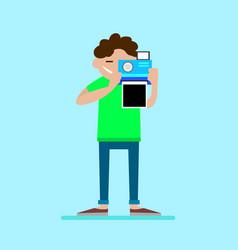 man shoots on the polaroid vector image