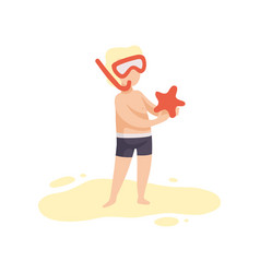 cute boy in diving mask holding starfish kid vector image