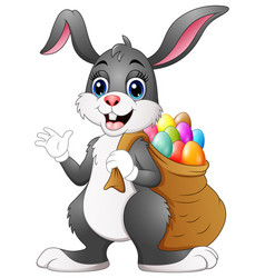 Easter bunny rabbit with easter eggs a sack of ful vector