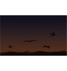 Pterodactyl on sky landscape of silhouettes vector
