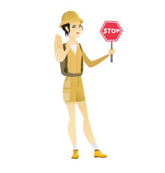 asian traveler holding stop road sign vector image vector image