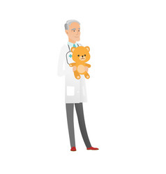 senior caucasian pediatrician holding teddy bear vector image