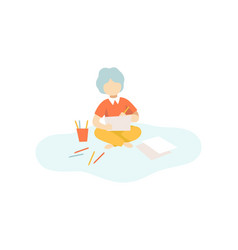 cute boy sitting on floor and drawing with pencils vector image