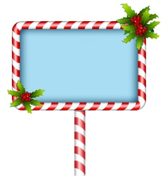 Candy cane billboard with holly on white vector