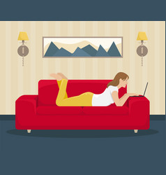 girl works at the laptop lying on the couch vector image