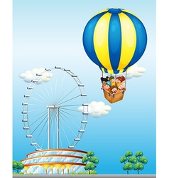 Children riding on giant balloon in sky vector image vector image