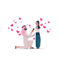 Arab man kneeling holding engagement ring vector