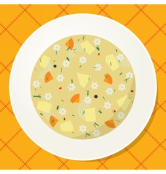 Plate with noodle and vegetable soup on the table vector image