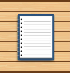 Blank realistic spiral notepad notebook on wooden vector