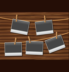 five photo frames hanging on rope vector image