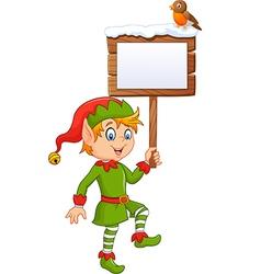 Cartoon funny elf boy holding blank sign vector image