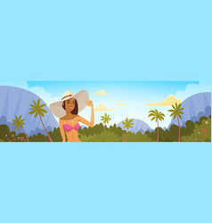 Tanned woman in bikini over tropical forest vector