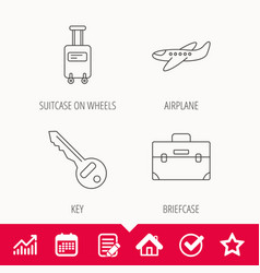 Suitcase on wheels key and airplane icons vector
