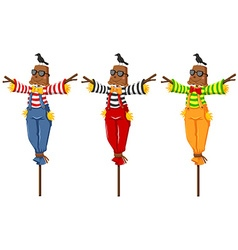 Three scarecrows on wooden sticks vector image vector image