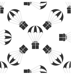 gift box flying on parachute icon seamless pattern vector image