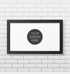 Realistic black frame on the brick wall vector image