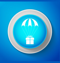 white gift box flying on parachute icon isolated vector image