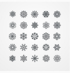 collection of black snowflakes on a white vector image