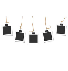 Blank paper photo frame hanging on a black paper vector