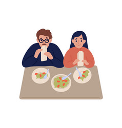 Hungry couple eat falafel in pita sit at table vector