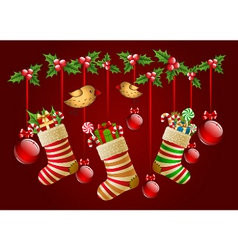 Hanging christmas socks with present and balls vector