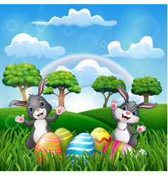 happy easter with two bunnies on the nature vector image