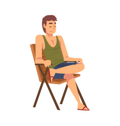 Relaxed young man sitting in beach chair lounging vector