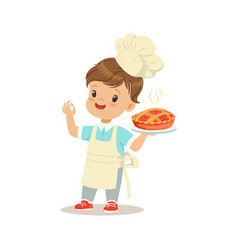 Cute little boy holding a freshly cooked pie vector