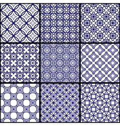 A set of blue seamless geometric patterns vector image