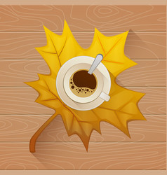 Coffee cup on the autumn fall leaves and wooden vector