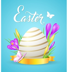 Easter card with egg and violet crocuses vector image