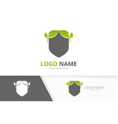 Shield and leaves logo design template premium vector
