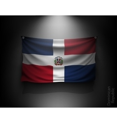 waving flag Dominican Republic on a dark wall vector image vector image