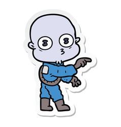 Sticker of a cartoon weird bald spaceman pointing vector