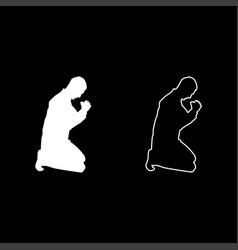 Man pray on his knees silhouette icon set white vector