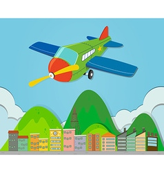 Airplane flying over a town vector image