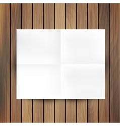 White folded paper mockup card isolated on wood vector image