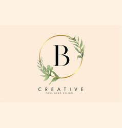 B letter logo design with golden circles vector