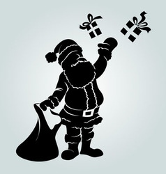 silhouette of Santa Claus with a gifts vector image