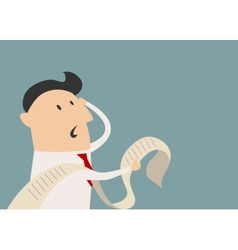 Worried businessman looking on the report vector image