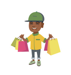 happy african-american boy holding shopping bags vector image vector image