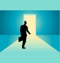 Businessman walking towards a bright door vector