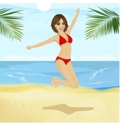 Young woman in bikini jumping on beach vector image