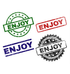 Damaged textured enjoy stamp seals vector