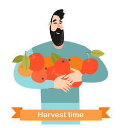 Happy man is holding ripe apples in hands vector