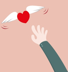 Heart flying away from hand vector image